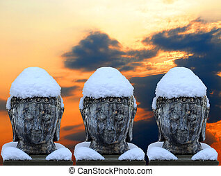 Three busts of Buddha with snowy hat and collar