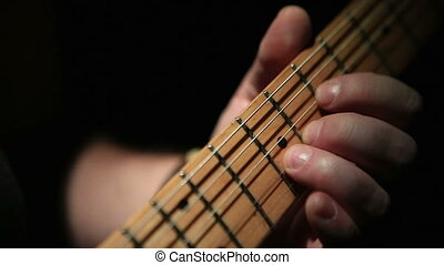 Guitar Solo Closeup - Closeup shot of guitar fretboard while...