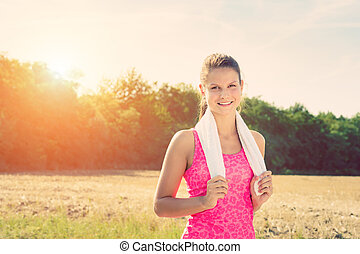 Attractive female taking a break after jogging