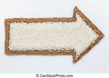 Pointer with rice grains, on white background