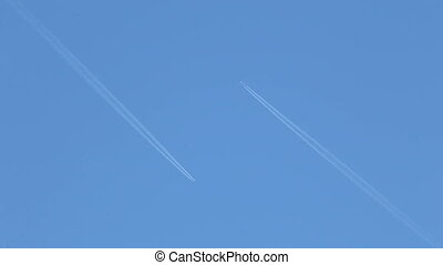 Airplanes in the Sky - Two airplains passing by each other...
