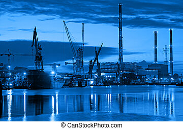 Shipyard at night - industry concept.