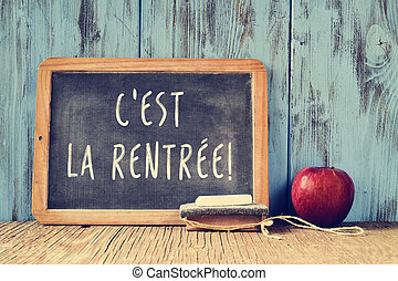 text cest la rentree, back to school in french, written on a chalkboard, cross processed