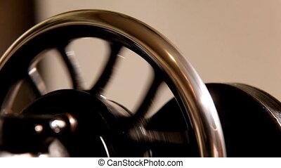 Pan on wheel of stitching machine