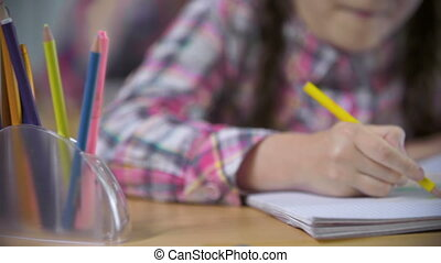 Girl Using Imagination - School girl drawing with colored...