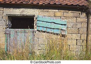 old stable door - a weathered stable door and barn with old...