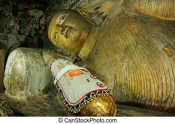 Reclining Buddha at Golden Temple of Dambulla in Sri Lanka....