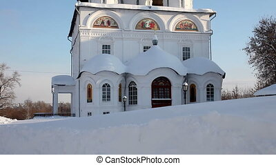 Pan on Christian monastery in winter sunny day