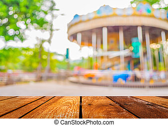 blur theme park - blur image of roundabout in theme park for...