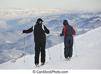 winter ski - skiers group of+have fun and relaxation on...