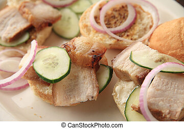 Small sandwiches of pork belly