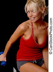 Health and Fitness Girl - Beautiful young blond lady doing a...