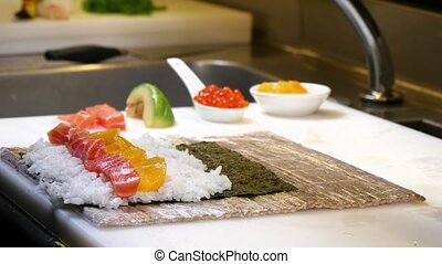 Sushi Chef Cooking Salmon Futomaki - A sushiman cooking...