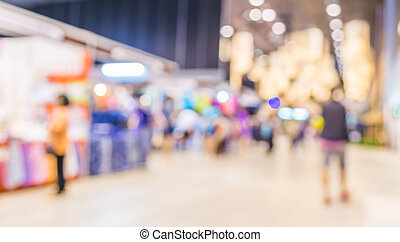 blurred image of shopping mall and people for background...