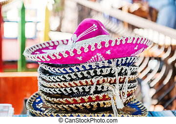 Stack of sombreros at a market in Mexico - A stack of...
