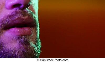 Profile of a person smoking shisha at restaurant - Profile...