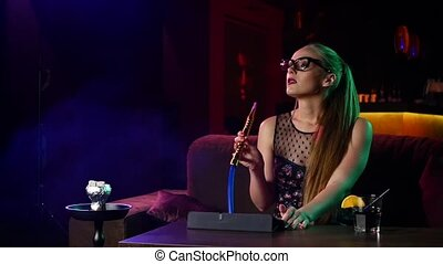 young girl with glasses resting in the hookah room Slow...