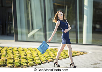 woman with a bag of shopping
