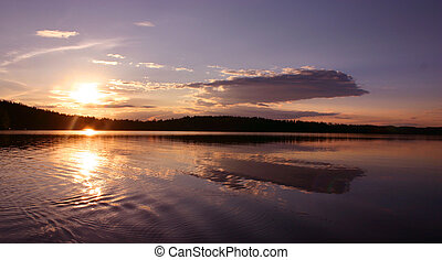 Midnight sun lake panorama in colorful summer evening sunset