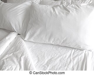 White Sheets - Detail of bed with set of crisp white sheets...