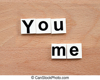 You and me, word concept on wooden background