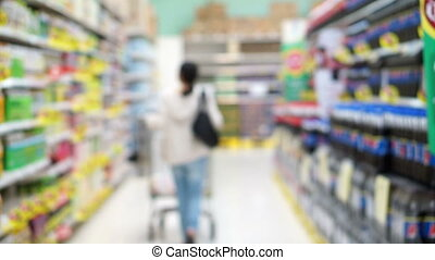 Asian shopping in blur super market - Asian girl, woman...