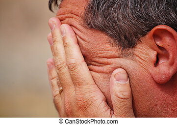 White man with hands on his face - white man expressing...