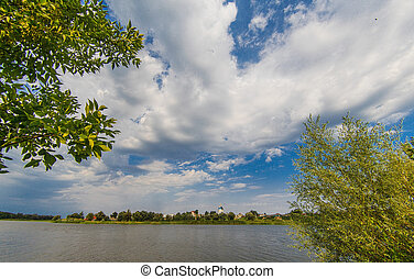 Russian summer landscape of the river and the blue sky with clouds