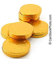 Chocolate gold coin stacks, isolated, portrait view