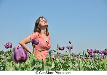 Young woman in field of poppies - Young woman enjoying life...