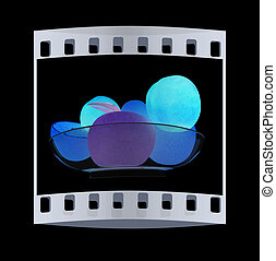 Citrus and apple on a plate. The film strip