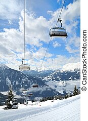 Ski lift in winter mountain landscape - Empty ski lift in...
