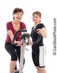 Senior woman with trainer - Spinning senior woman with coach