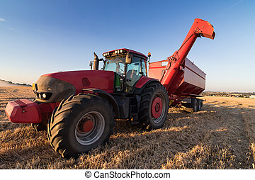 Agriculture tractor on a stubble field