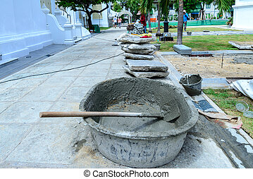 Cement mixing with salver at construction site.