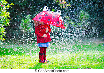 Little girl in red jacket playing in autumn rain - Little...