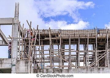Outdoor worker in construction building.