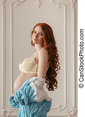 Pregnant woman with hands over tummy - Portrait of a pretty...