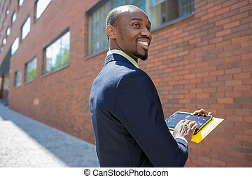 The business black man with laptop