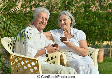 Senior couple resting during vacation on dance floor