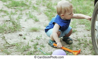 Son are repairing car - On Nature son baby pushing car