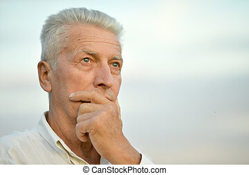 Senior man thinking - Portrait of a senior man thinking...