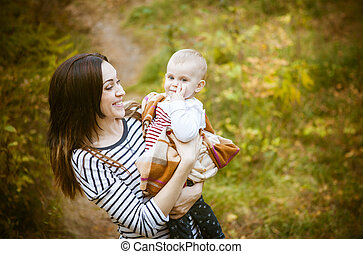 Mother with her baby daughter in autumn park - Young mother...
