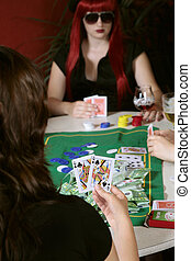 Poker game players holding cards