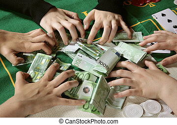 Greedy hands grabbing cash - Closeup of six greedy gamblers...
