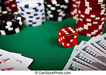 Poker chips, cards, dollar and dice on green table