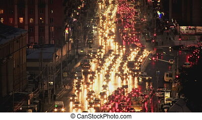 Night crossroads traffic in the city with lights HD