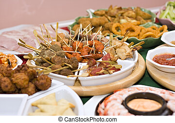 Party food - A table spread with delicious finger foods