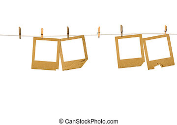 Old photo frames are hanging in the row isolated on white...