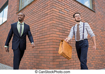 Portrait of multi ethnic business team Two happy smiling men...